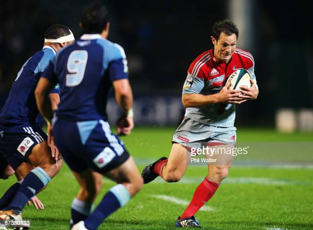 Leon MacDonald of the Crusaders makes a break during the round 14 Super 14 match between the Blues and the Crusaders at Eden Park on May 16 2009 in...