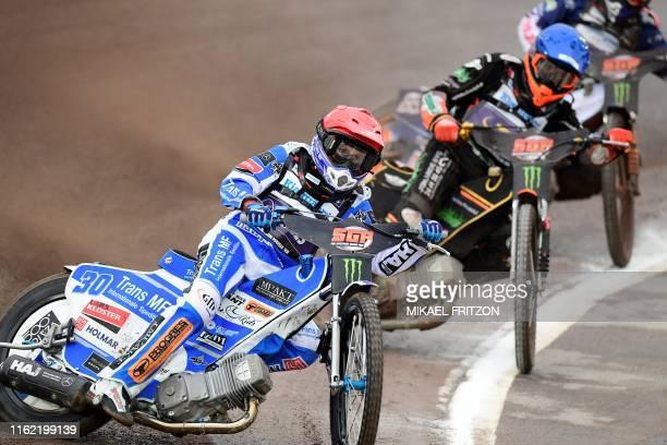 Leon Madsen of Denmark and Mikkel Michelsen of Denmark compete during the 2019 Scandinavian FIM Speedway Grand Prix, round 6, at G&B Arena on August...