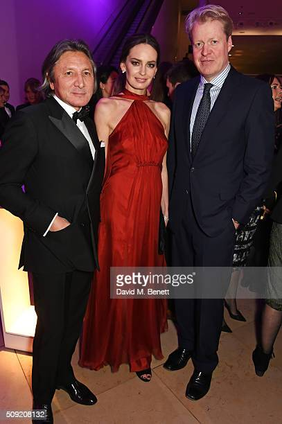 Leon Max Yana Max and Earl Charles Spencer attend a private view of Vogue 100 A Century of Style hosted by Alexandra Shulman and Leon Max at the...