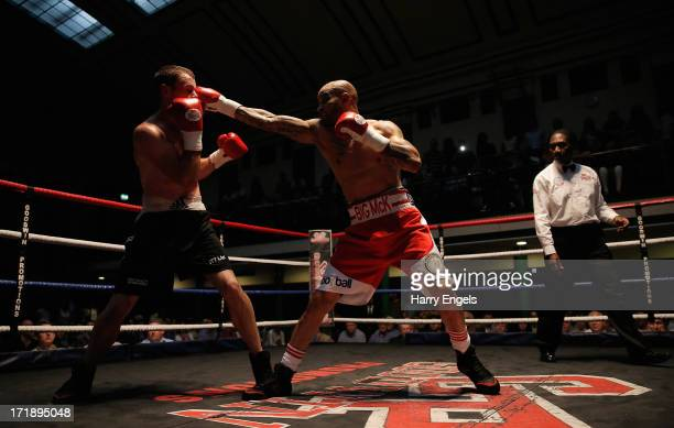 Leon McKenzie and John Mason in action during their Super Middleweight fight at York Hall on June 29, 2013 in London, England.