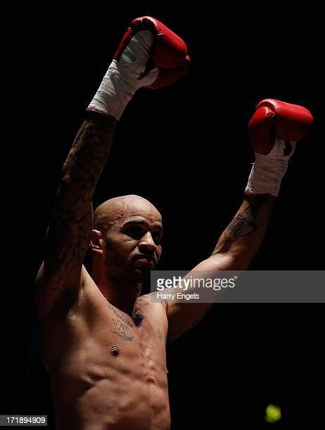 Leon McKenzie celebrates victory in his Super Middleweight fight with John Mason at York Hall on June 29, 2013 in London, England.
