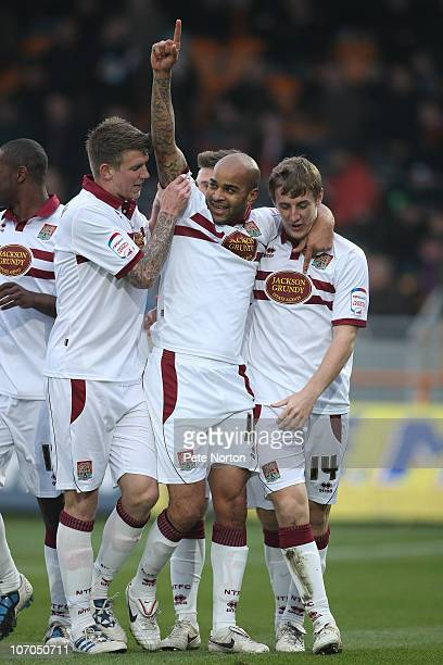 Leon McKenzie of Northampton Town celebrates after scoring his sides goal with team mates Dean Beckwith and John Johnson during the npower League Two...