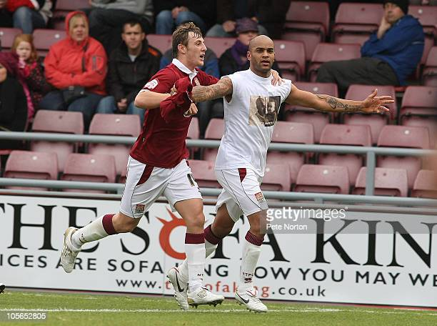 Leon McKenzie of Northampton Town is congratulated by team mate John Johnson after scoring his and his sides first goal McKenzie scored a first half...