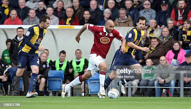 Leon McKenzie of Northampton Town moves between Ben Purkiss and Josh Payne of Oxford United during the npower League Two match between Oxford United...