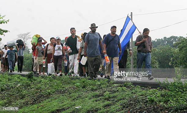 Peasants walk by the Panamerican road 23rd May 2007 in Leon about 83 km from Managua during the thirdday of a march to denounce the usage of harmful...