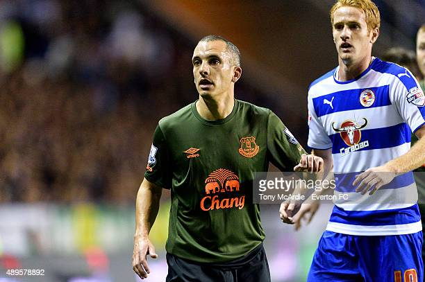 Leon Osman of Everton and Alex Fernandez during the Capital One Cup match between Reading and Everton at Madejski Stadium on September 22 2015 in...