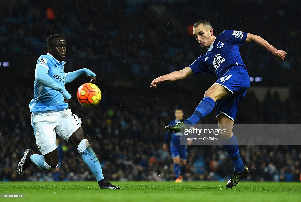 Leon Osman of Everton and Bacary Sagna of Manchester City compete for the ball during the Barclays Premier League match between Manchester City and Everton at the Etihad Stadium on January 13, 2016 in Manchester, England.