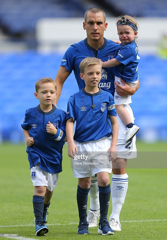 Leon Osman of Everton arrives on the pitch with his children for his testimonial match, the Pre-Season Friendly between Everton and Porto at Goodison Park on August 3, 2014 in Liverpool, England.