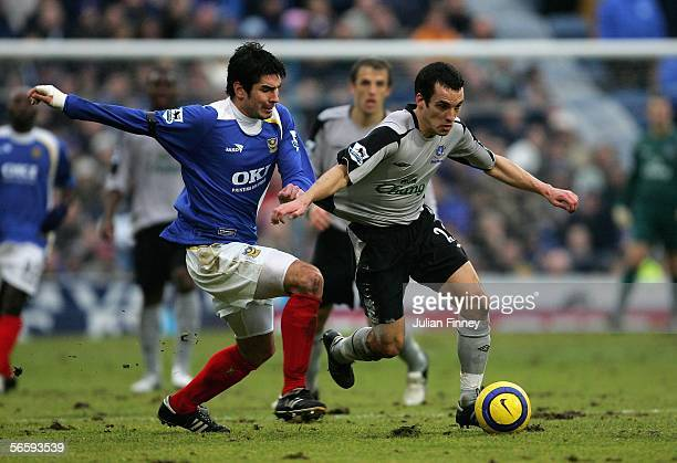 Leon Osman of Everton breaks away from Richard Hughes of Portsmouth during the Barclays Premiership match between Portsmouth and Everton at Fratton...