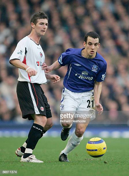 Leon Osman of Everton bursts pass Bryan Hughes of Charlton during the Barclays Premiership match between Everton and Charlton Athletic at Goodison...