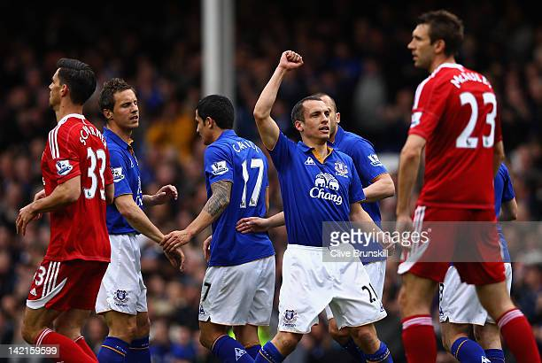 Leon Osman of Everton celebrates after scoring the first goal during the Barclays Premier League match between Everton and West Bromwich Albion at...