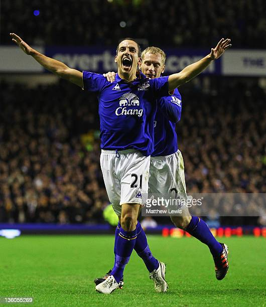Leon Osman of Everton celebrates his goal with Tony Hibbert during the Barclays Premier League match between Everton and Swansea City at Goodison...