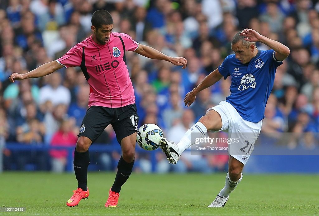 Leon Osman of Everton (R) challenges Evandro of Porto during the Pre-Season Friendly between Everton and Porto at Goodison Park on August 3, 2014 in Liverpool, England.
