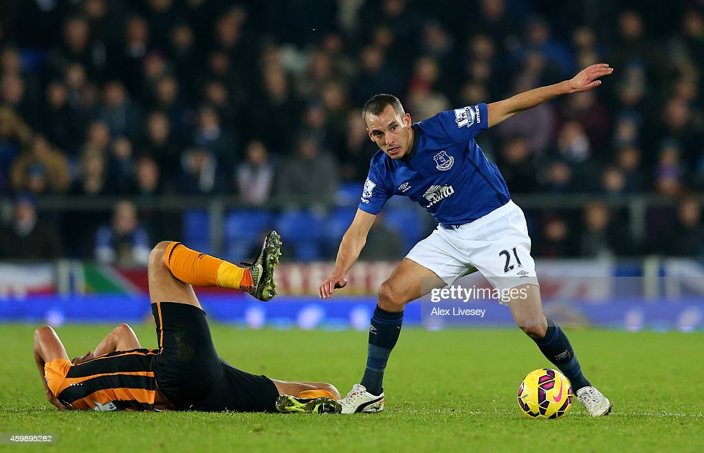 Leon Osman of Everton clashes with Jake Livermore of Hull City during the Barclays Premier League match between Everton and Hull City at Goodison Park on December 3, 2014 in Liverpool, England.