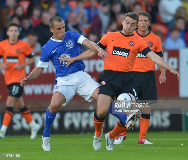 Leon Osman of Everton in action with Mark Miller of Dundee United during the preseason friendly match between Dundee United and Everton at Dens Park...
