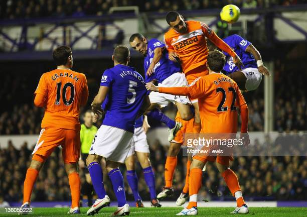 Leon Osman of Everton scores a goal during the Barclays Premier League match between Everton and Swansea City at Goodison Park on December 21 2011 in...