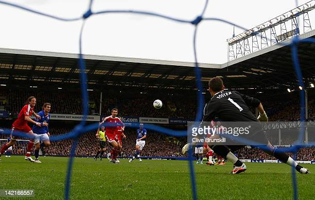 Leon Osman of Everton scores the first goal via a deflection during the Barclays Premier League match between Everton and West Bromwich Albion at...