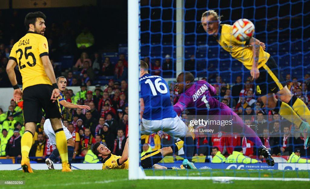 Leon Osman of Everton (obscured 2L) scores their first goal during the UEFA Europa League Group H match between Everton FC and LOSC Lille at Goodison Park on November 6, 2014 in Liverpool, United Kingdom.