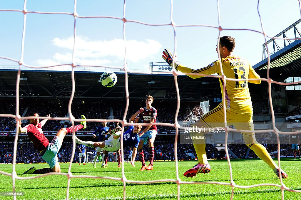 Leon Osman of Everton scores their first goal past Adrian of West Ham during the Barclays Premier League match between West Ham United and Everton at Boleyn Ground on May 16, 2015 in London, England.