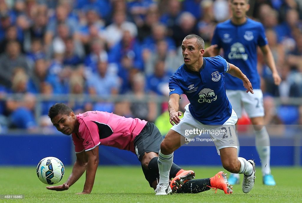 Leon Osman of Everton wins the ball from Casemiro of Porto during the Pre-Season Friendly between Everton and Porto at Goodison Park on August 3, 2014 in Liverpool, England.