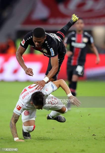 Leon Patrick Bailey of Bayer 04 Leverkusen crashes over M Zimmermann of Fortuna Duesseldorf during the Bundesliga match between Bayer 04 Leverkusen...