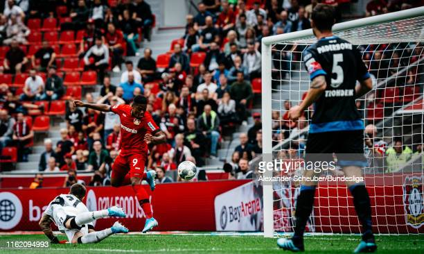 Leon Patrick Bailey of Bayer 04 Leverkusen scores the first goal for his team during the Bundesliga match between Bayer 04 Leverkusen and SC...