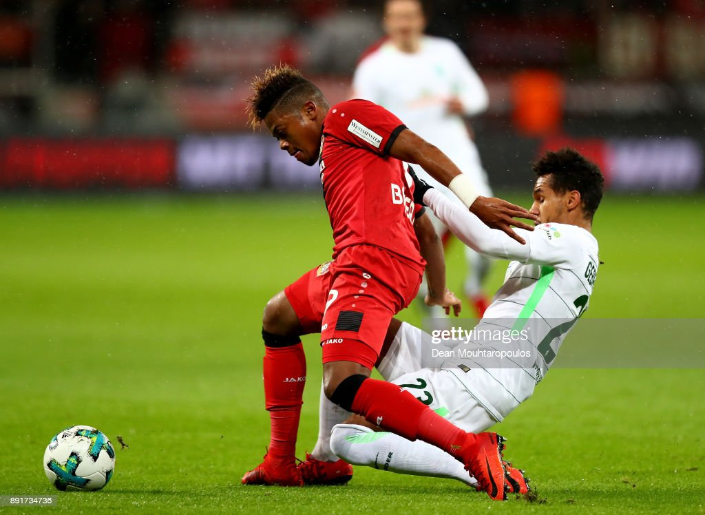 Leon Patrick Bailey (L) of Leverkusen and Theodor Gebre Selassie of Bremen battle for the ball during the Bundesliga match between Bayer 04 Leverkusen and SV Werder Bremen at BayArena on December 13, 2017 in Leverkusen, Germany.