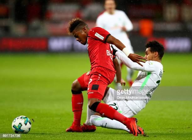 Leon Patrick Bailey of Leverkusen and Theodor Gebre Selassie of Bremen battle for the ball during the Bundesliga match between Bayer 04 Leverkusen...