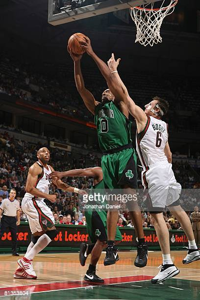 Leon Powe of the Boston Celtics goes to the basket under pressure against Andrew Bogut of the Milwaukee Bucks during the game on April 8 2008 at the...