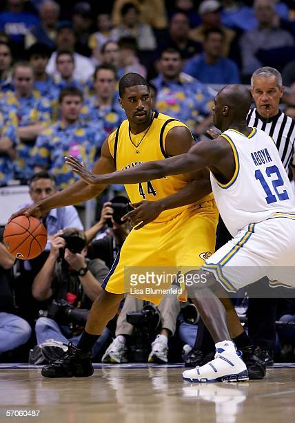 Leon Powe of the California Golden Bears is defended by Alfred Aboya of the UCLA Bruins during the championship final of the 2006 Pacific Life Pac10...