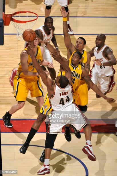 Leon Powe of the Cleveland Cavaliers has his shot blocked by Solomon Jones of the Indiana Pacers on March 17 2010 at The Quicken Loans Arena in...