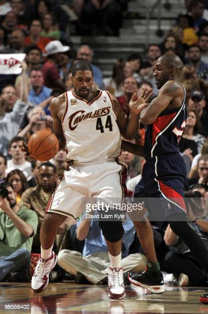 Leon Powe of the Cleveland Cavaliers makes a move against Joe Smith of the Atlanta Hawks during the game at Quicken Loans Arena on April 02 2010 in...