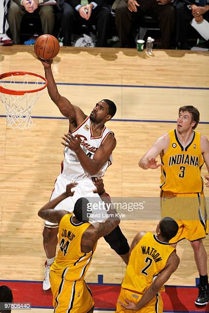 Leon Powe of the Cleveland Cavaliers puts up the shot surrounded by Solomon Jones Earl Watson and Troy Murphy of the Indiana Pacers on March 17 2010...