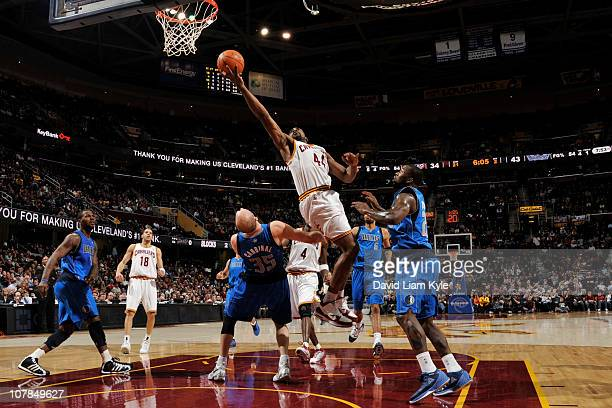Leon Powe of the Cleveland Cavaliers shoots against Brian Cardinal of the Dallas Mavericks at The Quicken Loans Arena on January 2 2011 in Cleveland...