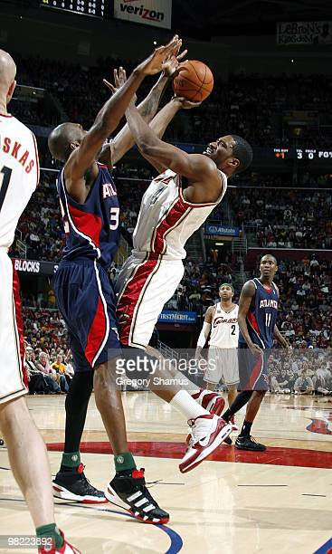 Leon Powe of the Cleveland Cavaliers tries to get a shot off over Joe Smith of the Atlanta Hawks on April 2 2010 at the Quicken Loans Arena in...