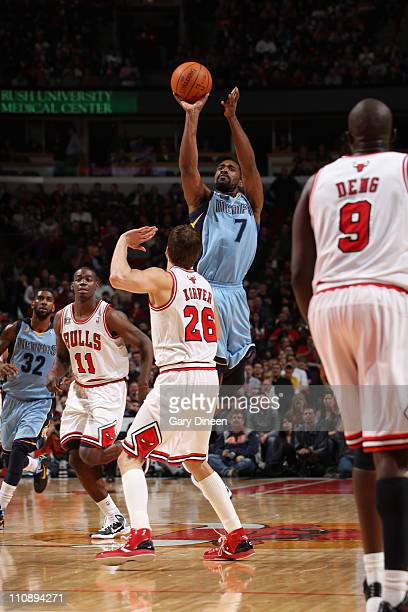 Leon Powe of the Memphis Grizzlies shoots over Kyle Korver of the Chicago Bulls on March 25 2011 at the United Center in Chicago Illinois NOTE TO...