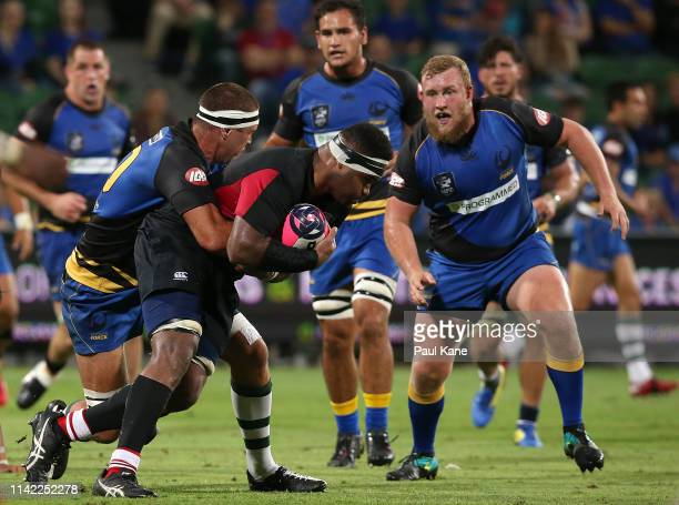 Leon Power of the Force tackles Joketani Koroi of the Dragons during the Rapid Rugby match between the Western Force and the Asia Pacific Dragons at...