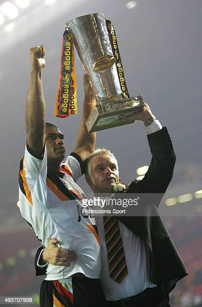 Leon Pryce and Brian Noble of Bradford celebrates with the trophy after winning the Engage Super league Grand Final between Leeds Rhinos and Bradford...