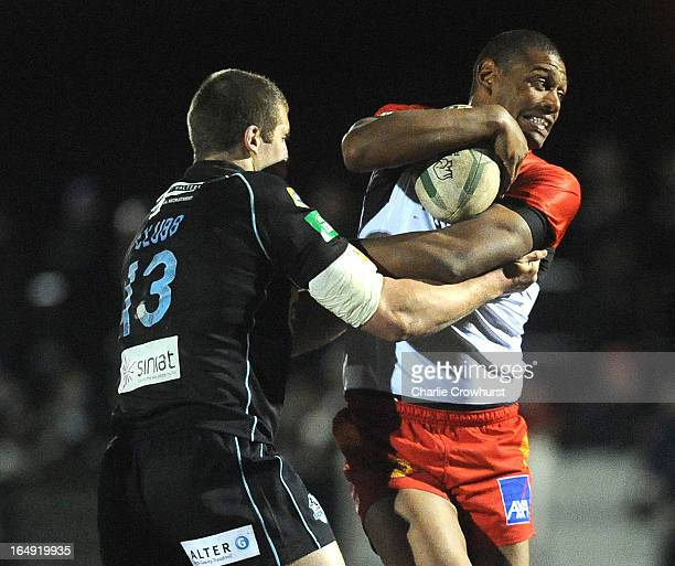 Leon Pryce of Catalan Dragons attacks and break away from Broncos' Tony Clubb during the Super League match between London Broncos and Catalan...
