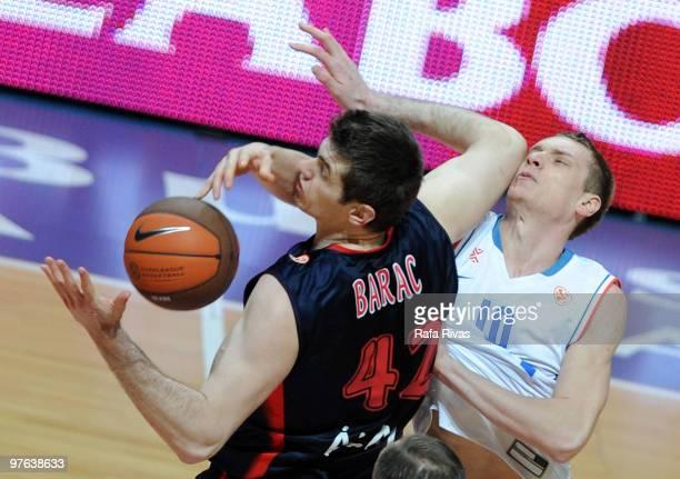 Leon Radosevic #10 of KK Cibona Zagreb competes with Stanko Barac #42 of Caja Laboral during the Euroleague Basketball 20092010 Last 16 Game 6...