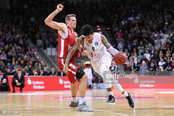 Leon Radosevic of Brose Bamberg defends against Julian Gamble of Telekom Baskets Bonn during the BBL Bundesliga match between Telekom Baskets Bonn...