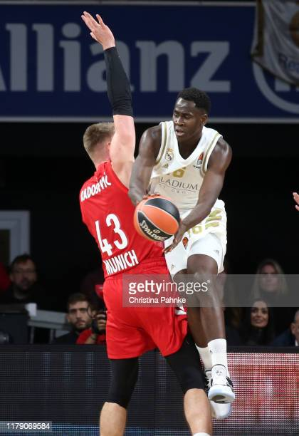 Leon Radosevic of FC Bayern Munich competes with Usman Garuba of Real Madrid in action during the 2019/2020 Turkish Airlines EuroLeague Regular...