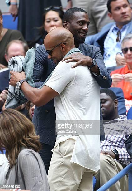 Leon Robinson hugs Boris Kodjoe while attending Venus and Serena Williams backtoback matches at Arthur Ashe Stadium on day 8 of the 2016 US Open at...