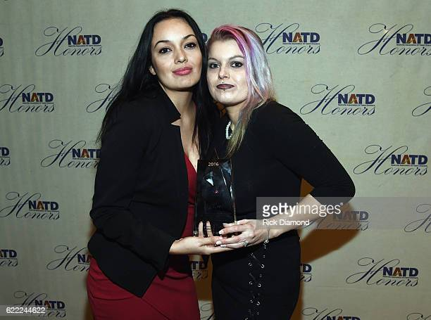 Leon Russell's daughters Sugaree Noel and CoCo Russell accept for Honoree Leon Russell at the 2016 NATD Honors Gala at Hermitage Hotel on November 9...