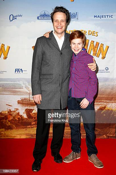 Leon Seidel and August Diehl attend 'Die Abenteuer des Huck Finn' Germany Premiere on December 16 2012 in Berlin Germany