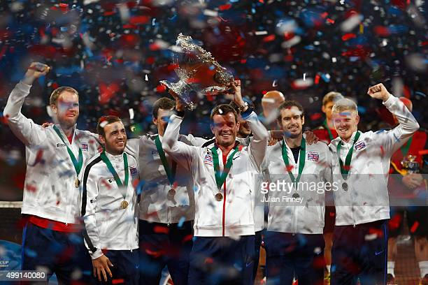 Leon Smith the Captain of Great Britain holds aloft the Davis Cup following his team's victory on day three of the Davis Cup Final 2015 at Flanders...