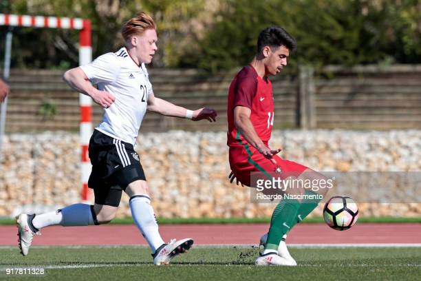 Leon Sommer of Germany U17 challenges Joao Ferreira of Portugal U17 during U17Juniors Algarve Cup match between U17 Portugal and U17 Germany at Bela...