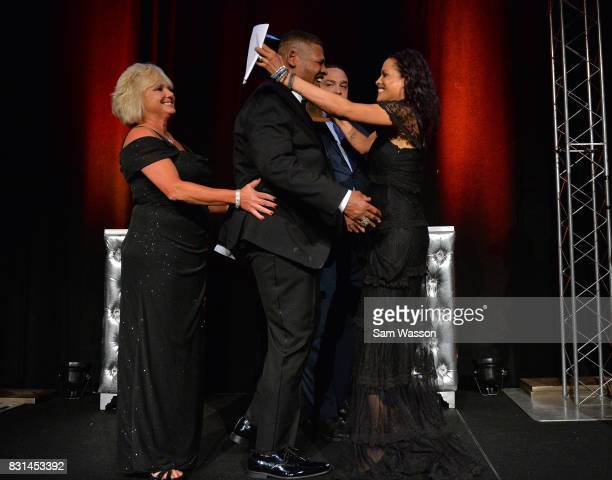 Leon Spinks is greeted by Rasheda Ali as Spinks is inducted into the Nevada Boxing Hall of Fame at the fifth annual induction gala at Caesars Palace...