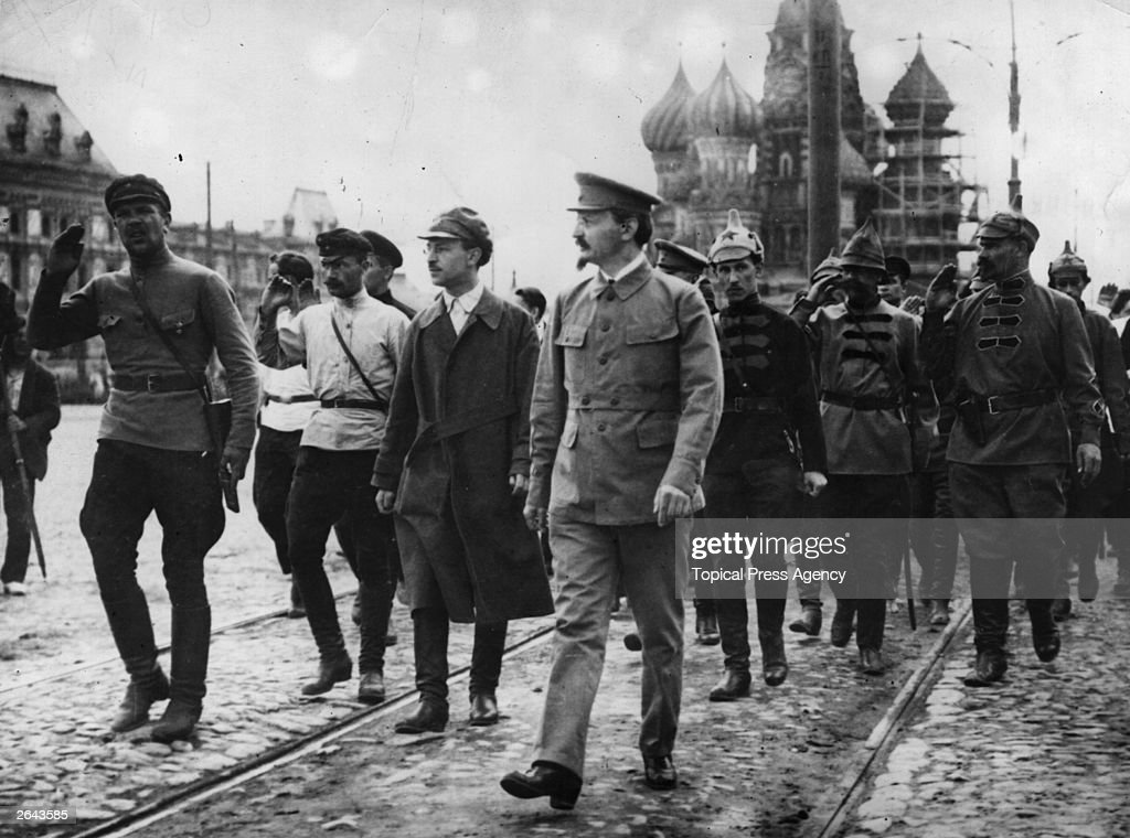 Leon Trotsky (1879 - 1940) reviews the Red Band in Moscow.