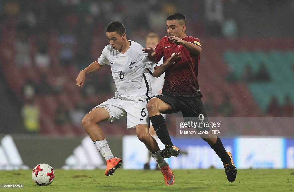 Leon Van Den Hoven of New Zealand and Malik Karaahmet of Turkey challenge for the ball during the FIFA U-17 World Cup India 2017 group B match between New Zealand and Turkey at Dr DY Patil Cricket Stadium on October 6, 2017 in Mumbai, India.